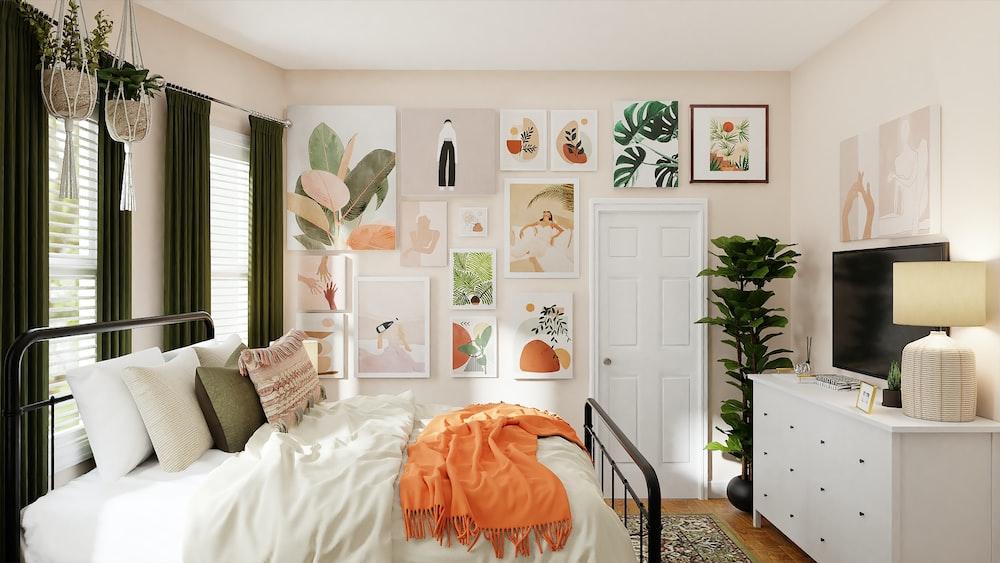 white bed with orange blanket