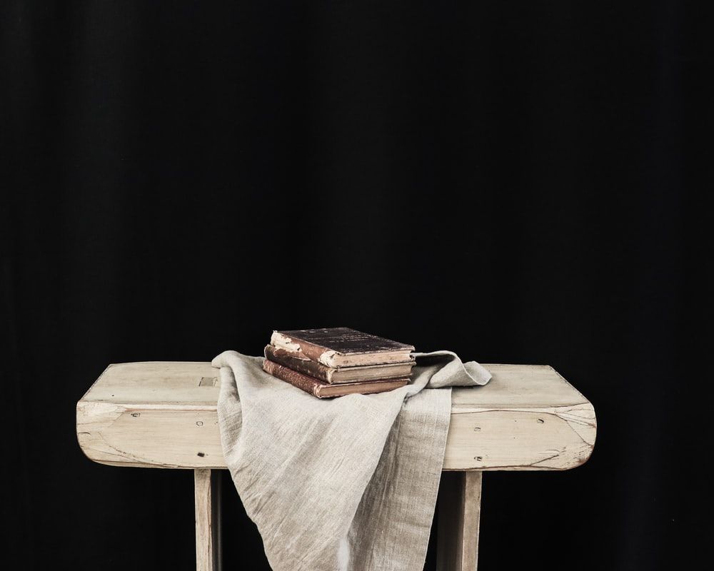 brown wooden chair with brown textile on top