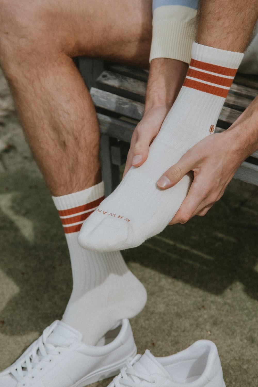 person wearing white nike socks