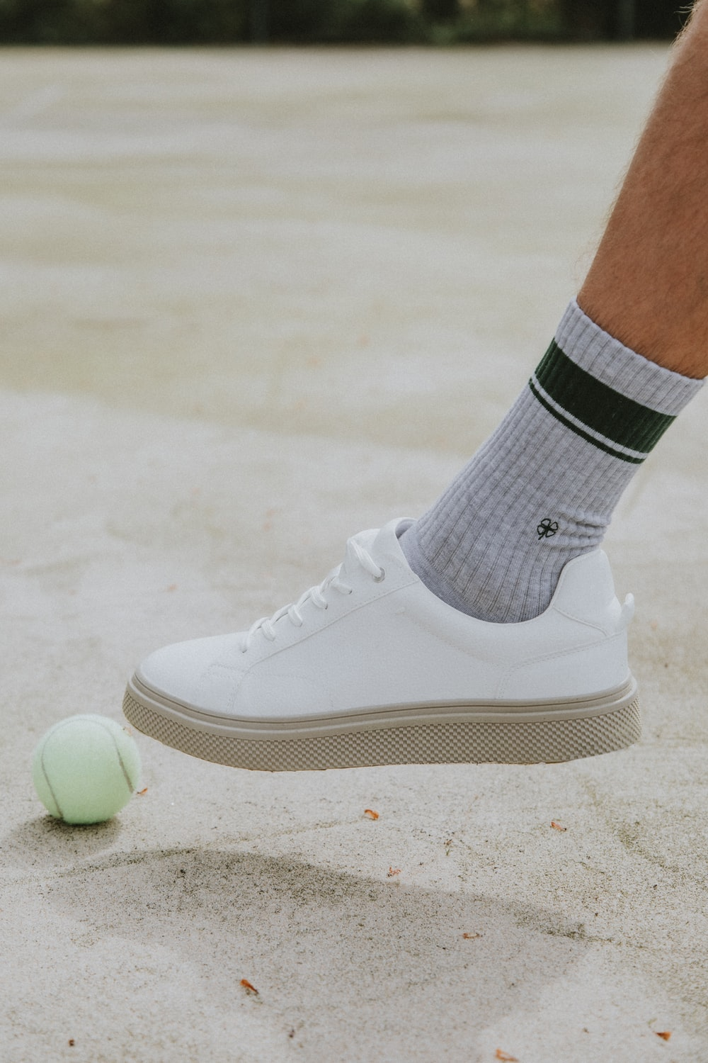 person wearing white nike sock and white nike low top sneaker