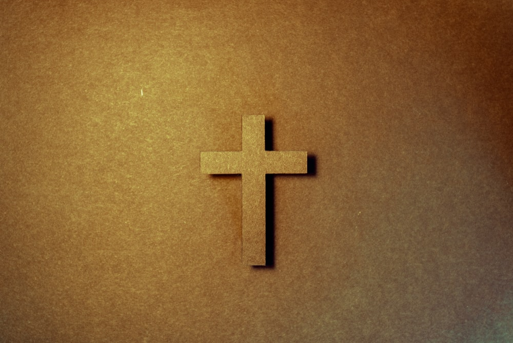 brown cross on brown surface