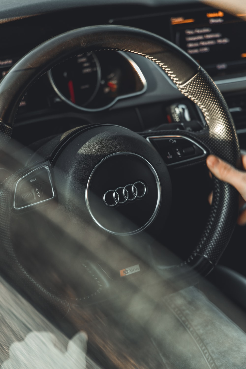 person holding black jeep steering wheel