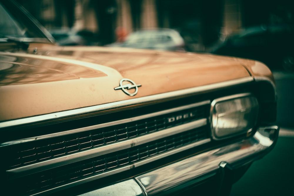 brown mercedes benz car in tilt shift lens