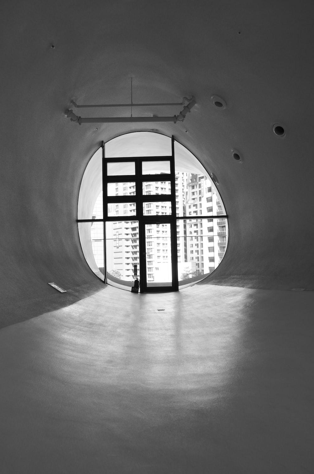 grayscale photo of black metal window frame