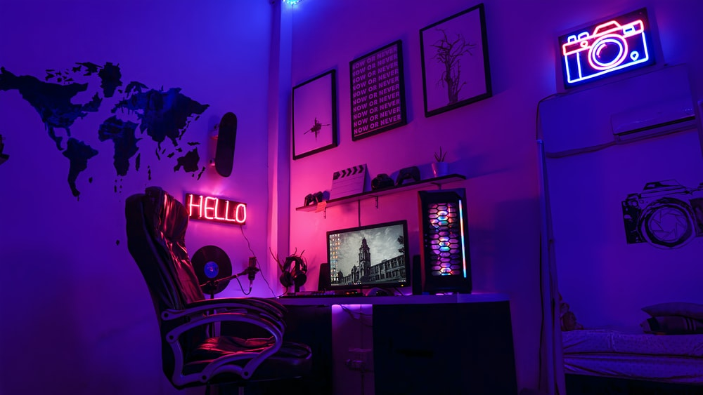 black flat screen tv turned on near white wall