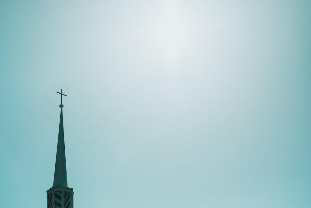 black cross on top of building
