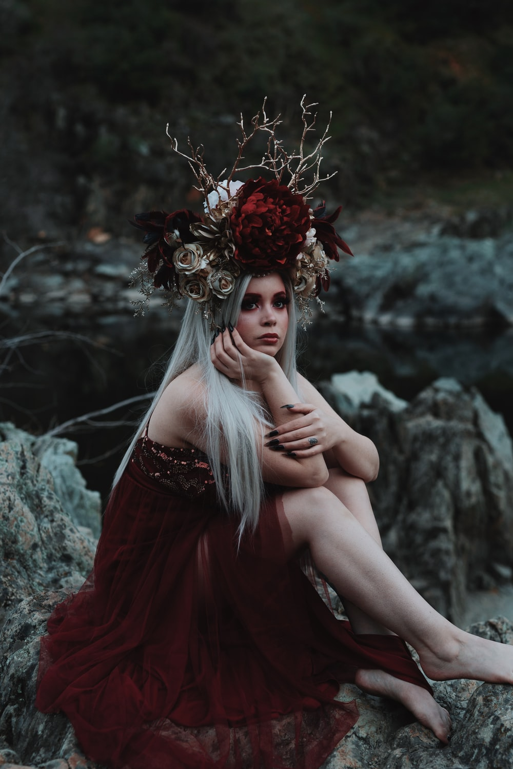 woman in red dress with red flowers on her head