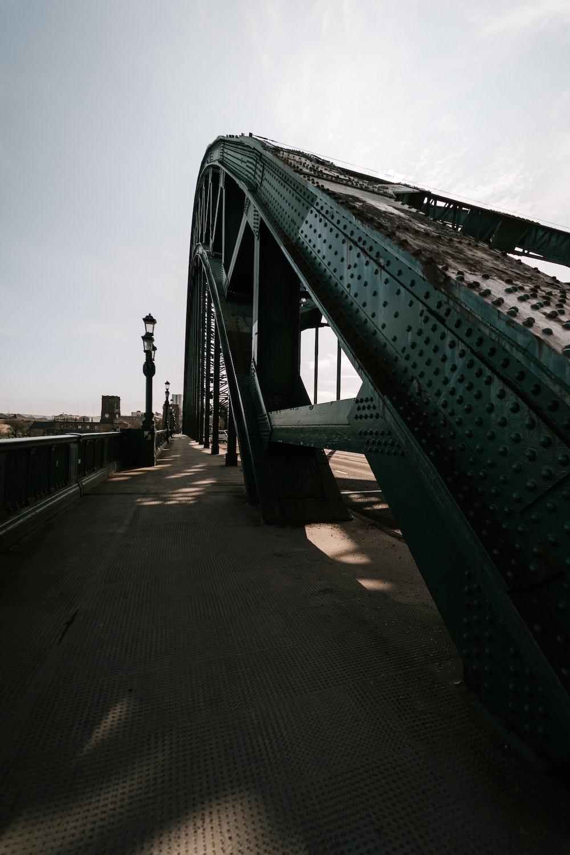 gray metal bridge under white sky during daytime