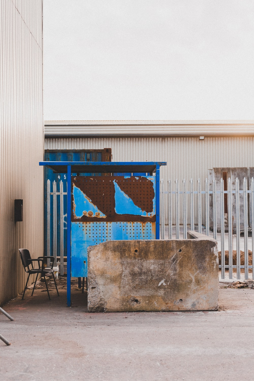 blue metal gate near white building