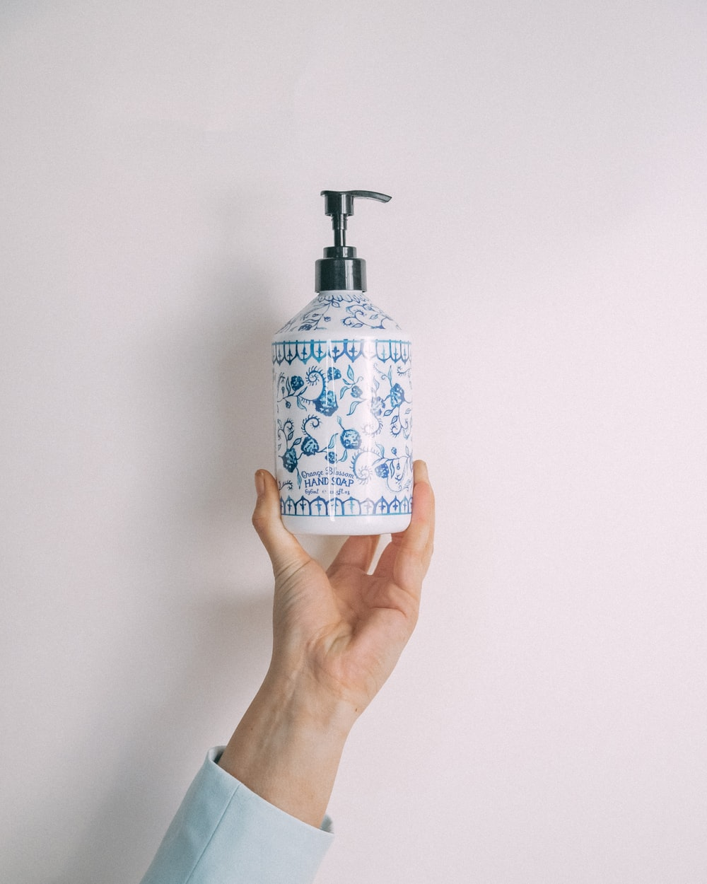 white and blue pump bottle