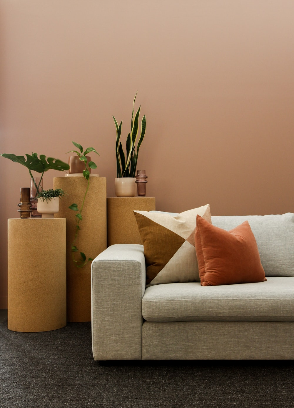 brown throw pillow on white couch