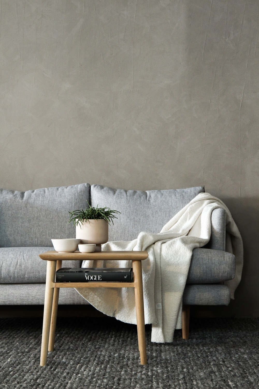 gray sofa with white towel