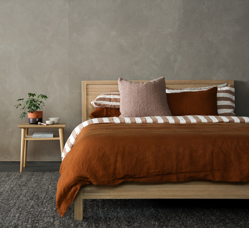 brown and white bed linen