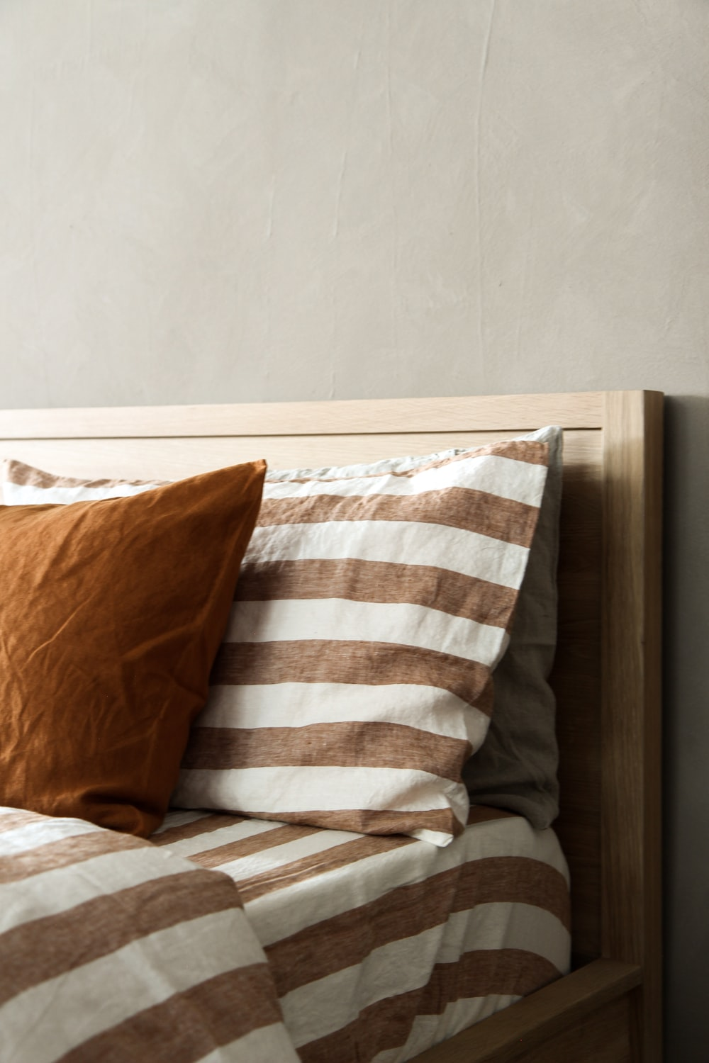 white and brown throw pillow