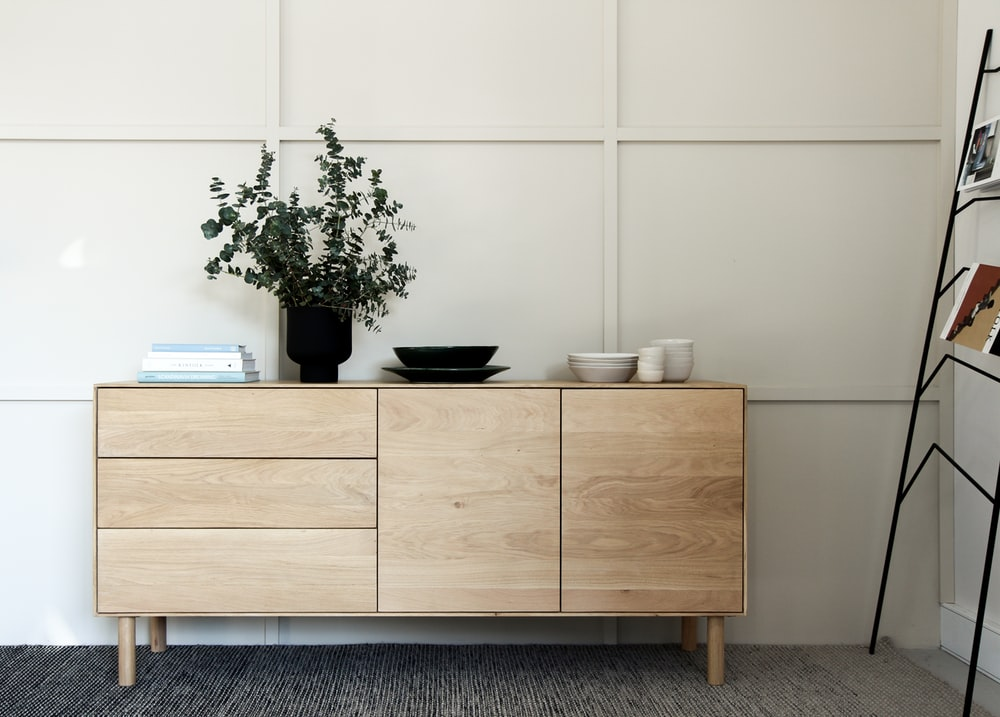 green potted plant on brown wooden cabinet