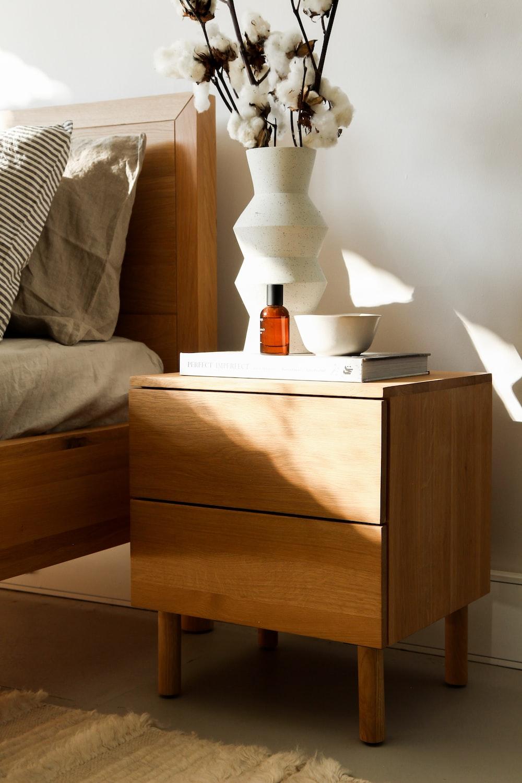 white ceramic vase on brown wooden nightstand
