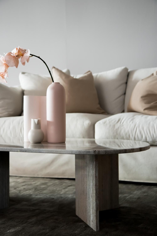 2 white pillar candles on white wooden table