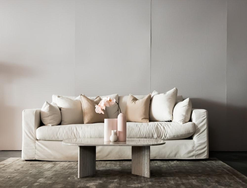 white throw pillows on white couch