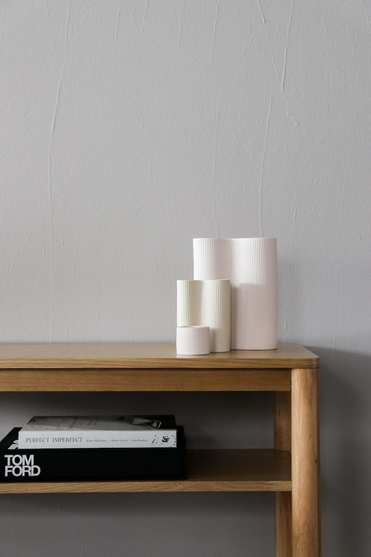 white plastic bottle on brown wooden shelf