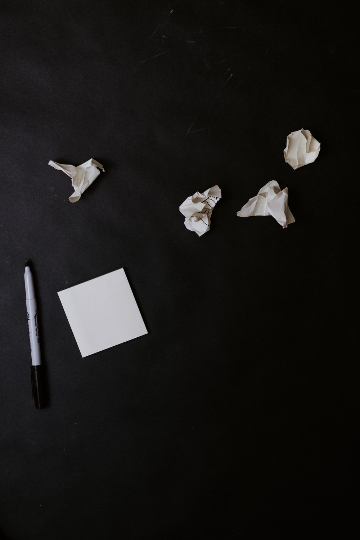 white paper on black table