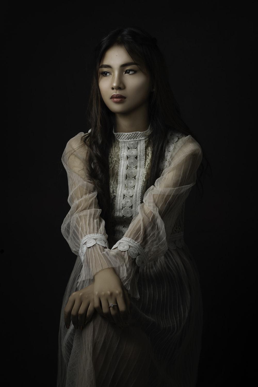 woman in white long sleeve dress