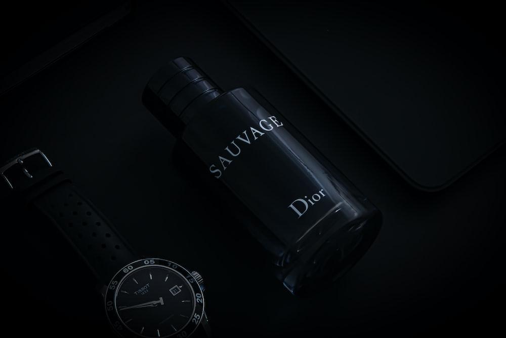 black and white round analog watch