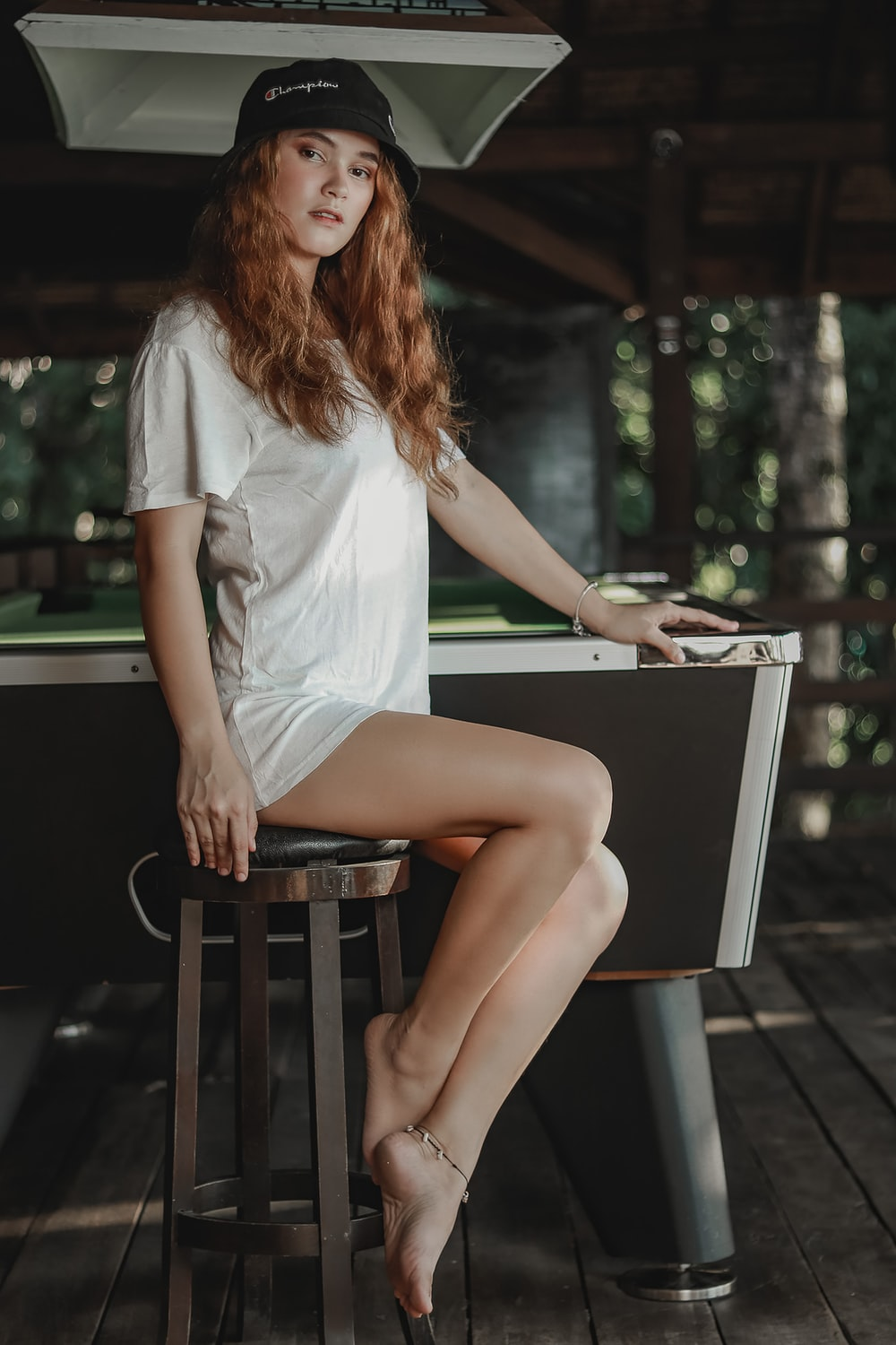 woman in white shirt sitting on black chair