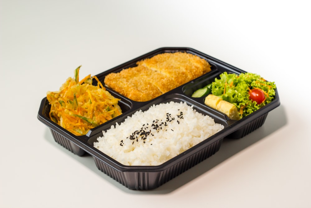 rice and rice on black plastic container