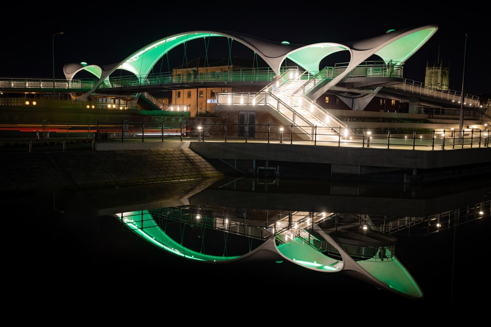 white and green concrete building during night time
