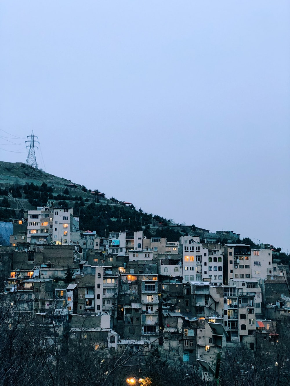 city with high rise buildings under gray sky during daytime