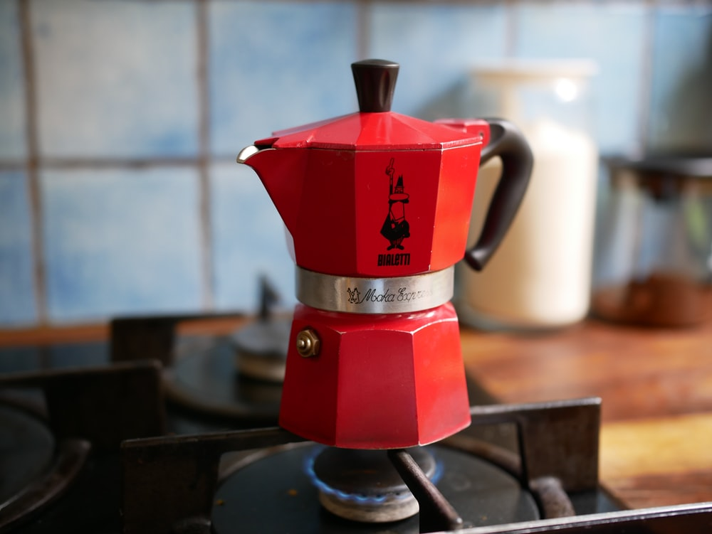 red and silver coffee maker
