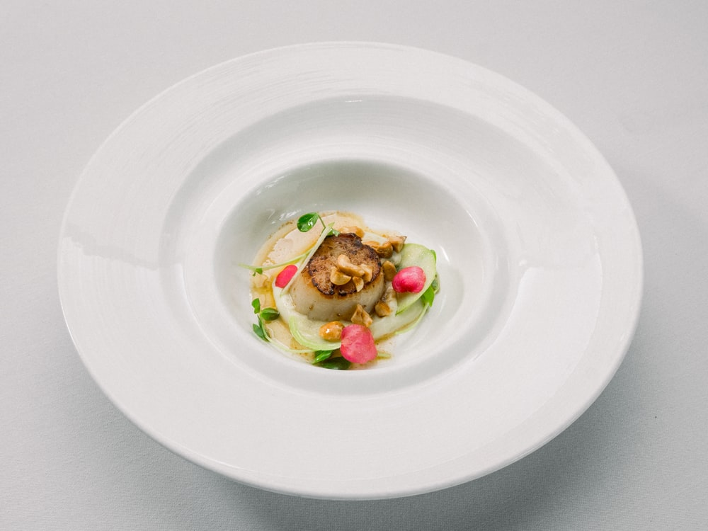 white ceramic plate with vegetable salad