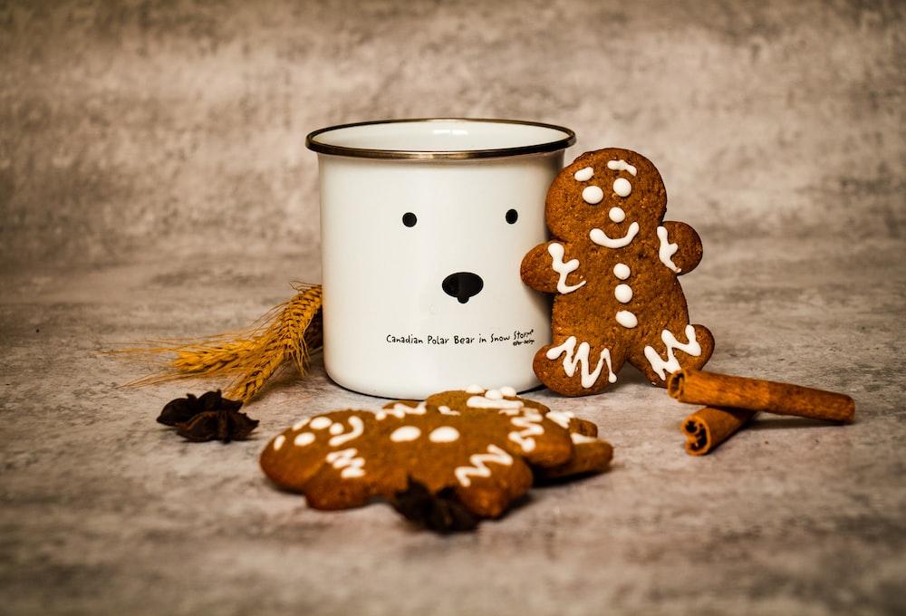 white and black polka dot ceramic mug on brown wooden table