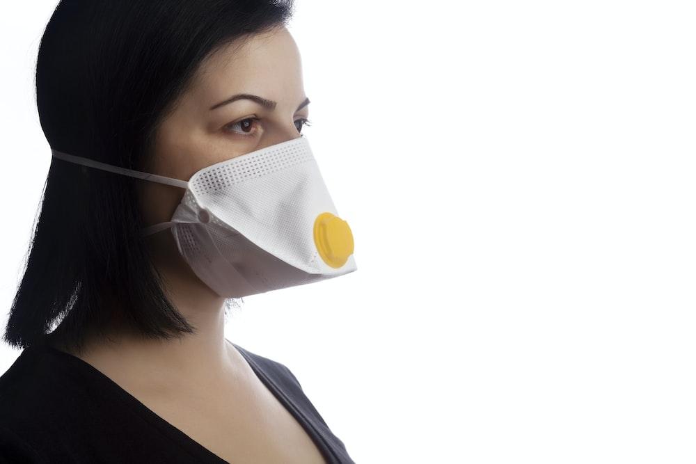 woman in white tank top wearing white mask