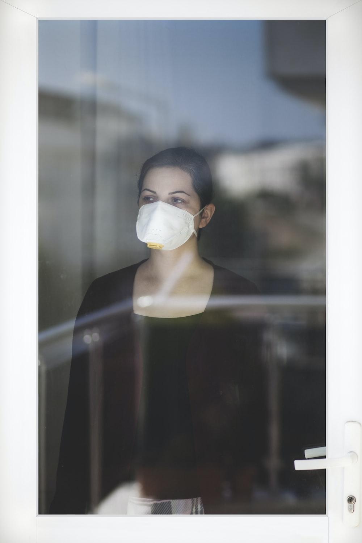 woman in black tank top wearing white face mask