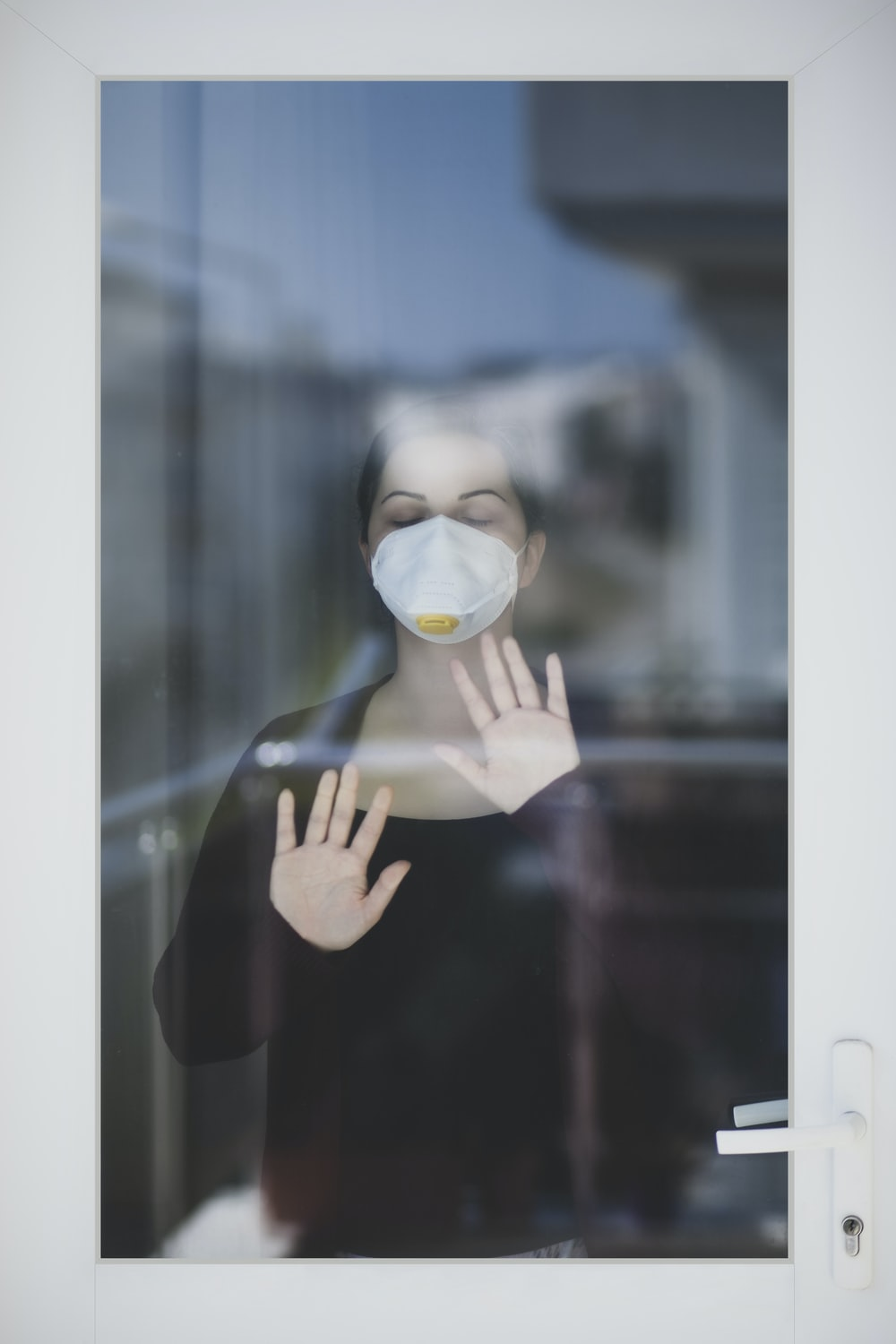 person holding white and yellow mask