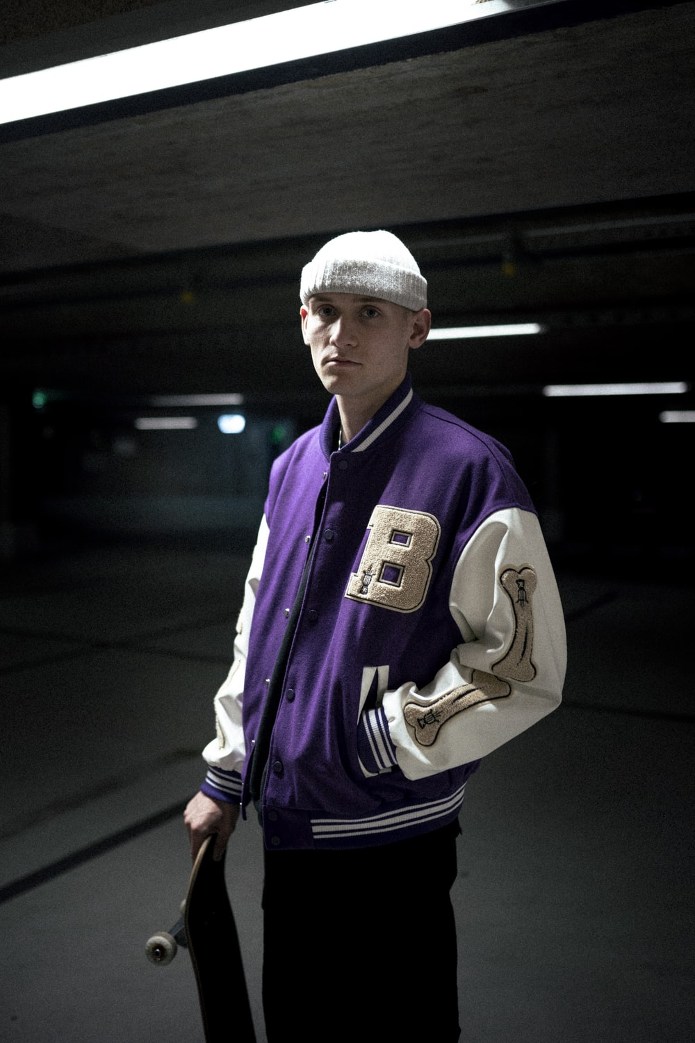 man in white knit cap and purple jacket