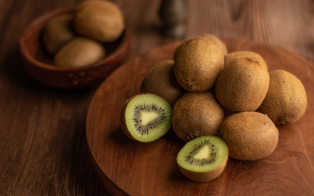 brown round fruit on brown wooden table