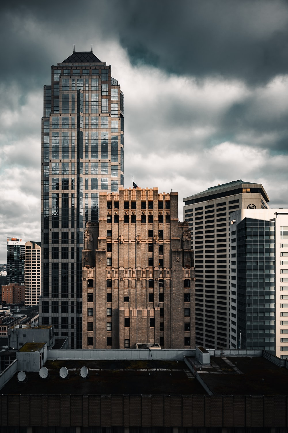 brown and black concrete building under gray clouds during daytime