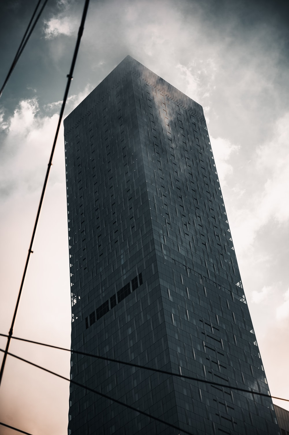 gray concrete building under white clouds during daytime