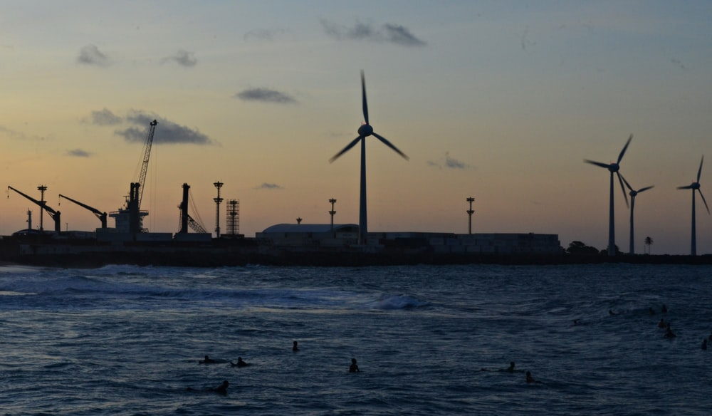 wind turbines on dock during daytime