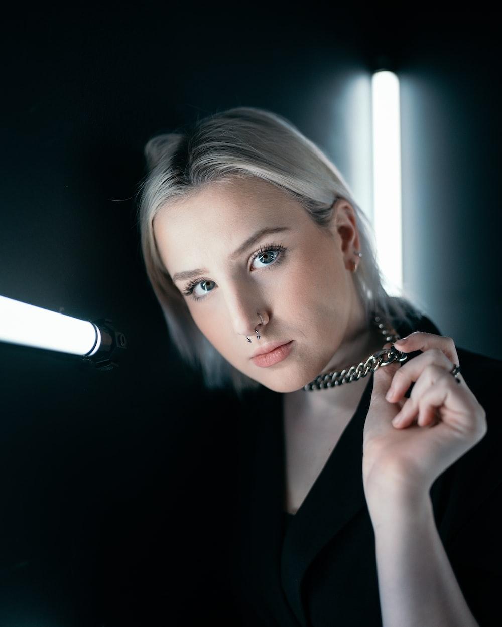 woman in black blazer holding microphone