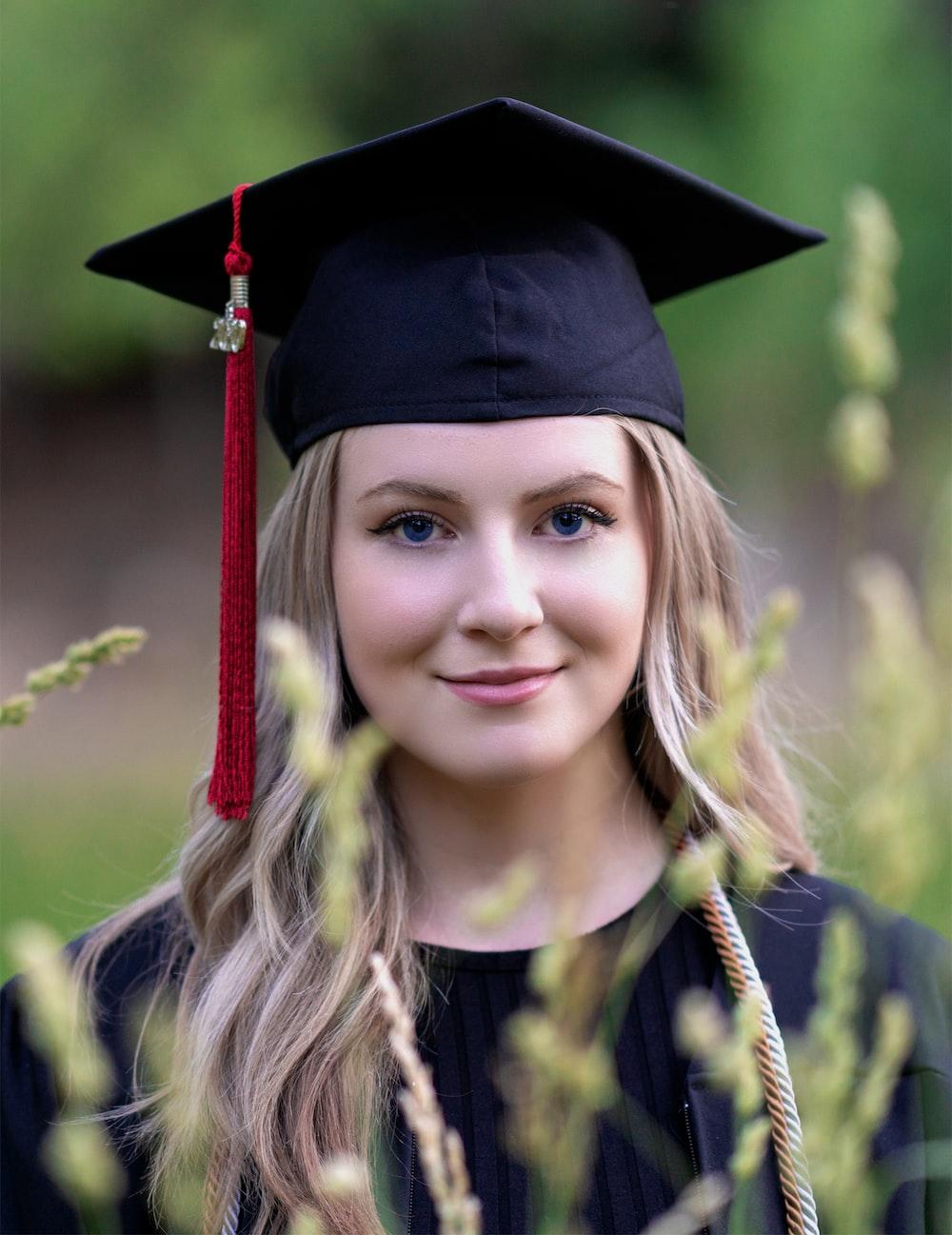 smiling girl wearing academic dress