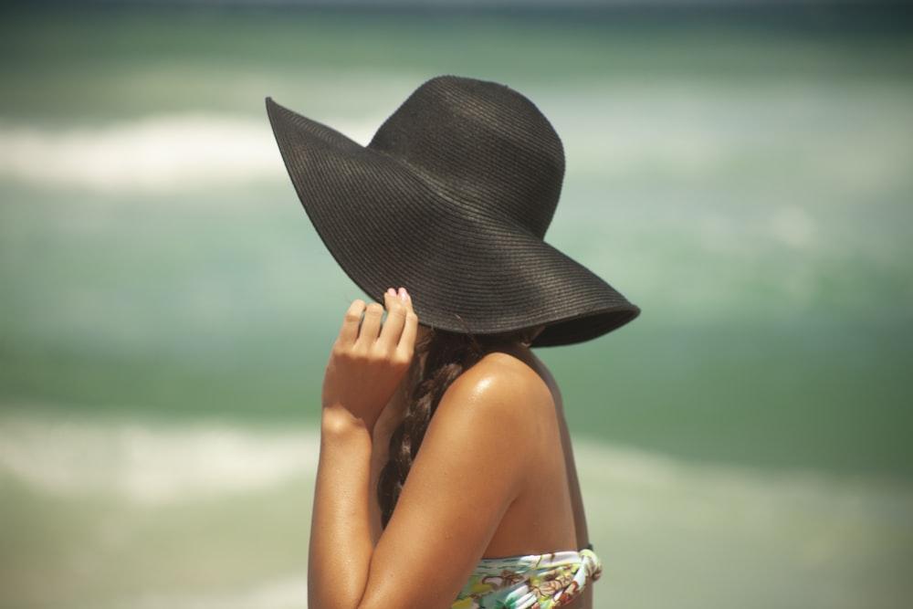 woman in black sun hat