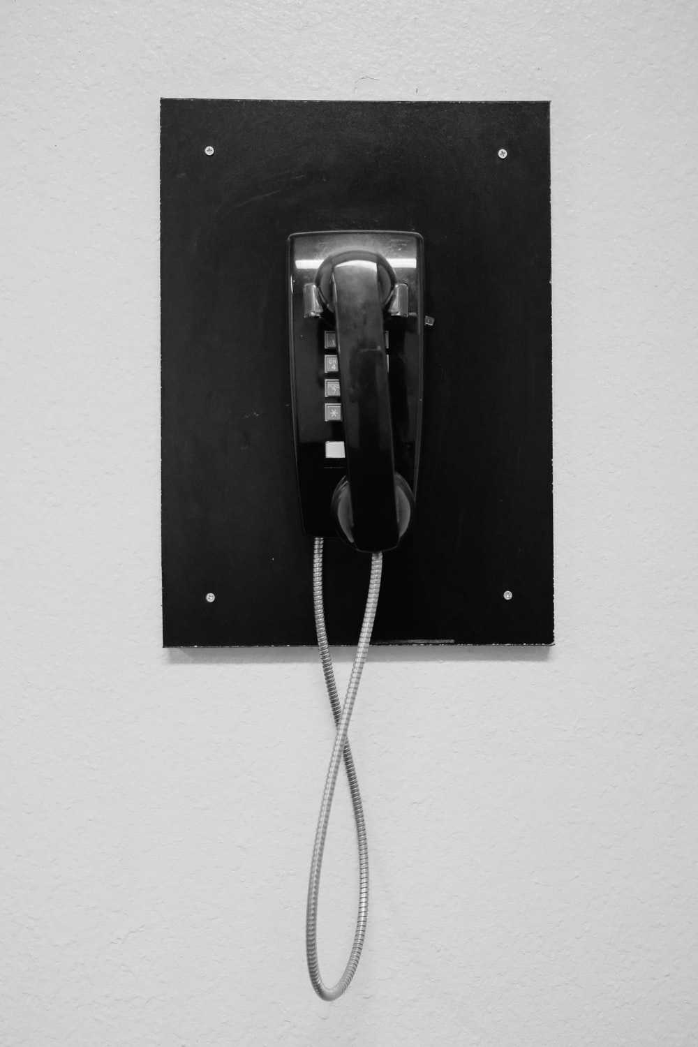 black telephone on white wall