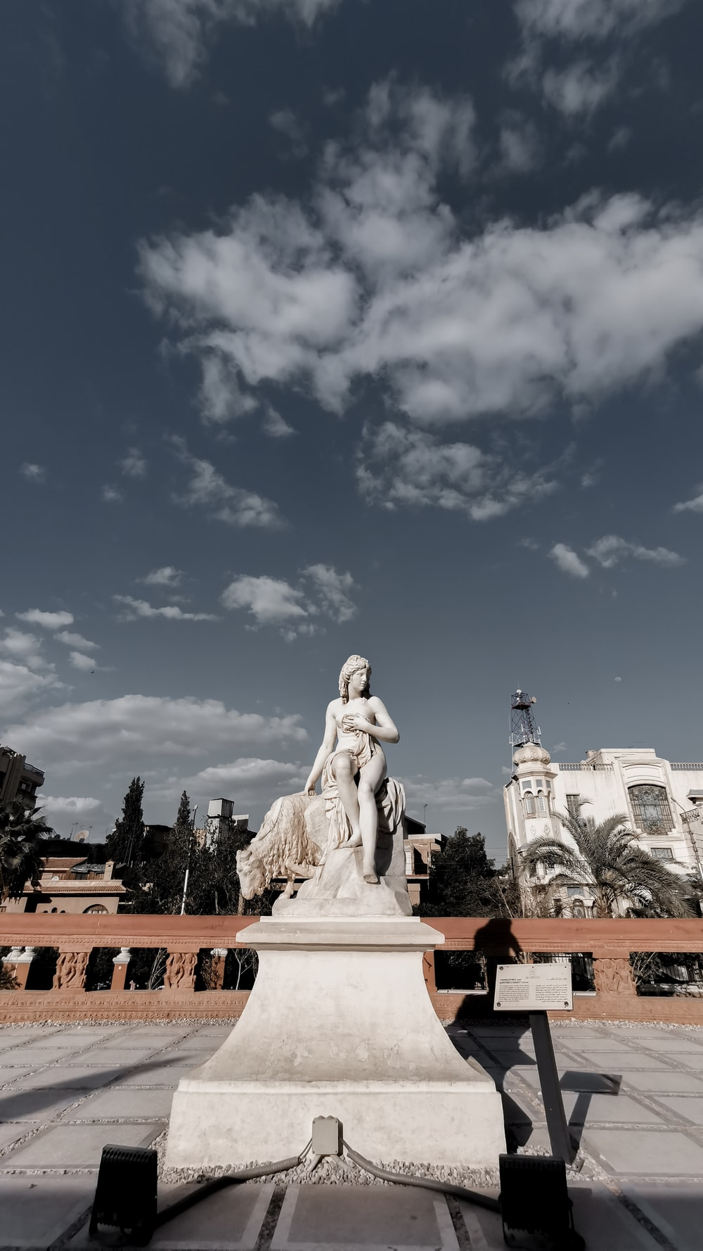 white concrete statue under blue sky during daytime