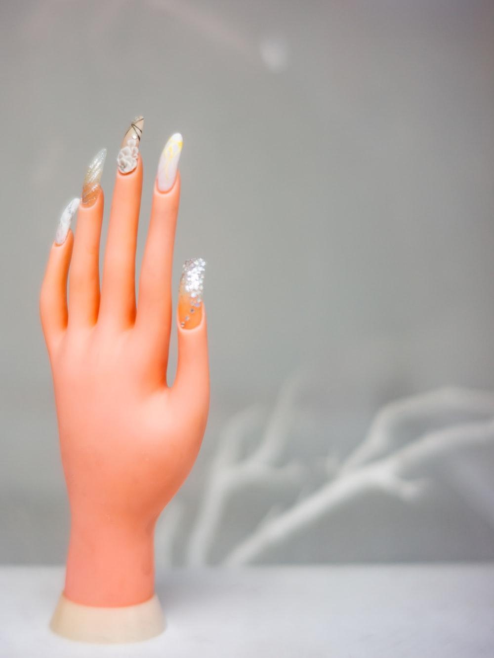 person with white nail polish