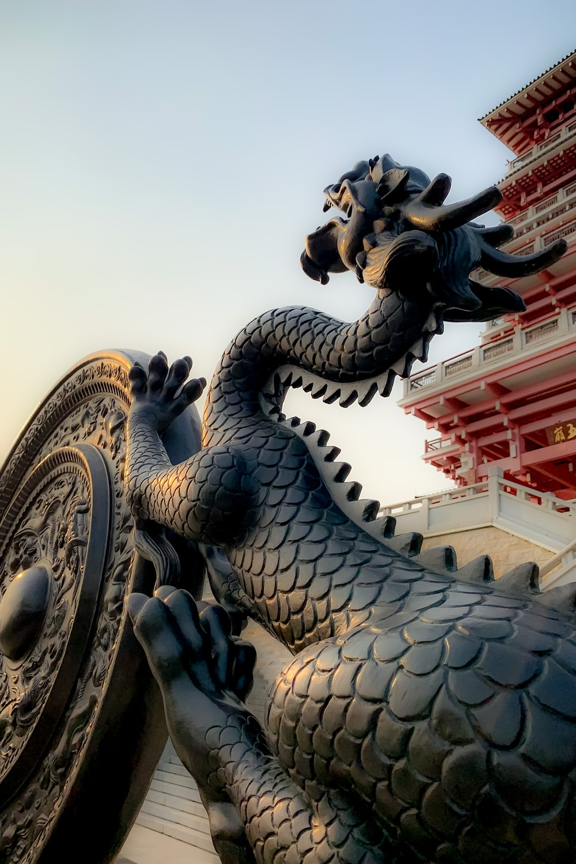 dragon statue under blue sky during daytime