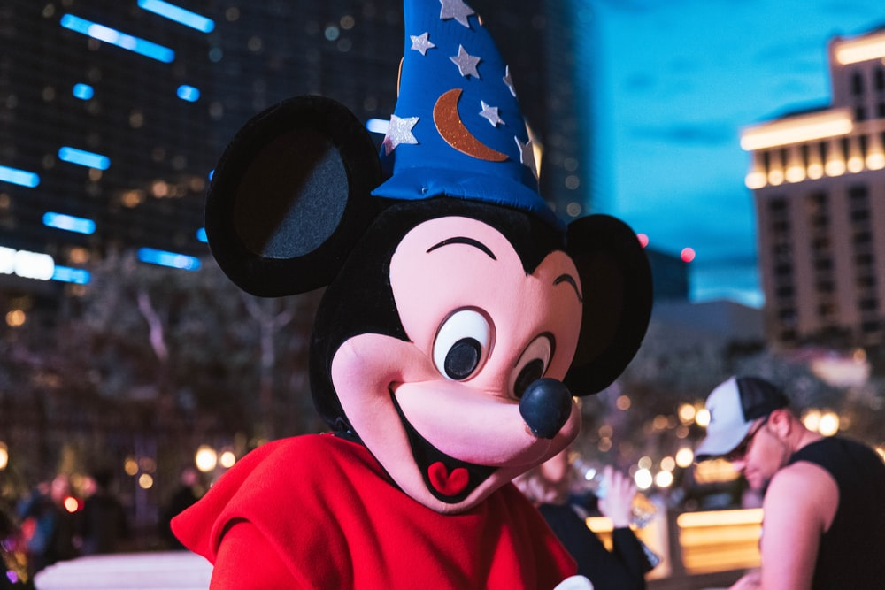 mickey mouse mascot in red jacket