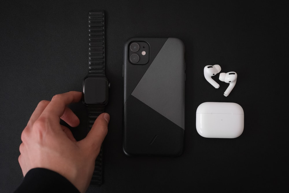 black iphone 7 with white apple airpods